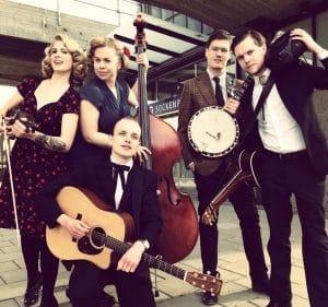 Bild på de fem medlemmarna i Spinning Jennies